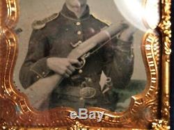 Authentic Civil War tin type of a Union Soldier holding three weapons
