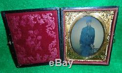 CASED DAGUERREOTYPE of YOUNG CIVIL WAR SOLDIER in CAP & FROCK COAT, HAND COLORED