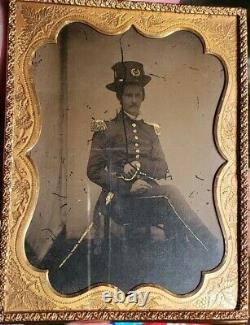 Half plate ambrotype of civil war US regular army officer armed with sword